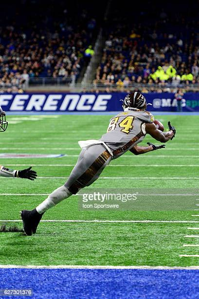 Western Michigan Broncos Wide Receiver Corey Davis tries to keep his feet in bounds as he goes for the catch during the MAC Championship game between...