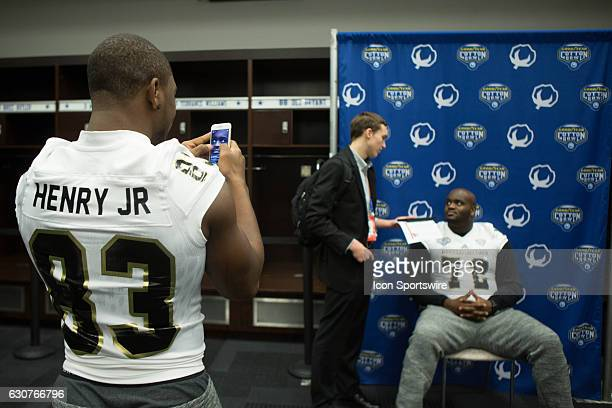 Western Michigan Broncos wide receiver Michael Henry takes pictures of Western Michigan Broncos offensive lineman Taylor Moton during the Cotton Bowl...