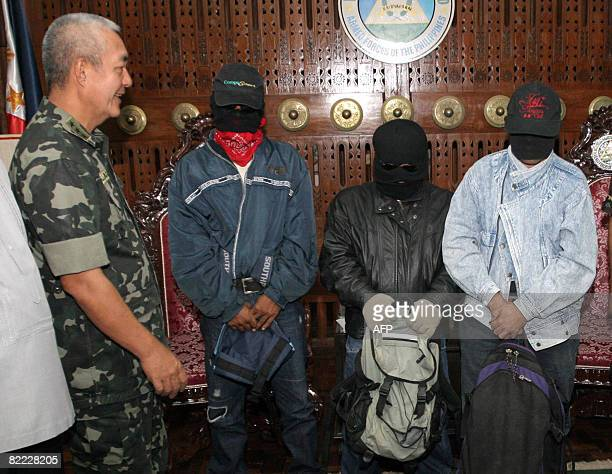 Western Mindanao Military Command chief Lieutenant General Nelson Allaga present three alleged informers who were awarded a total of 45 million pesos...