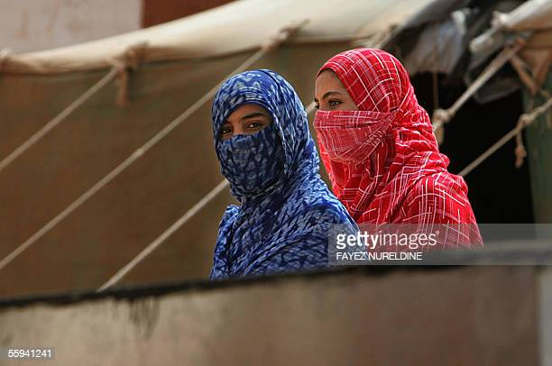 Western Saharian women walk along tents in the 27 February refugee camps of Tindouf home for three decades to the Western Saharan refugees in the...