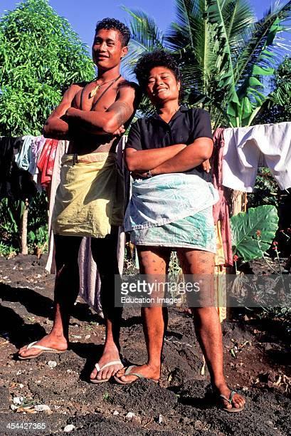 Western Samoa Island Of Savai'I Village Of Falealupo Portrait Of Samoan Man Woman With Tattoos