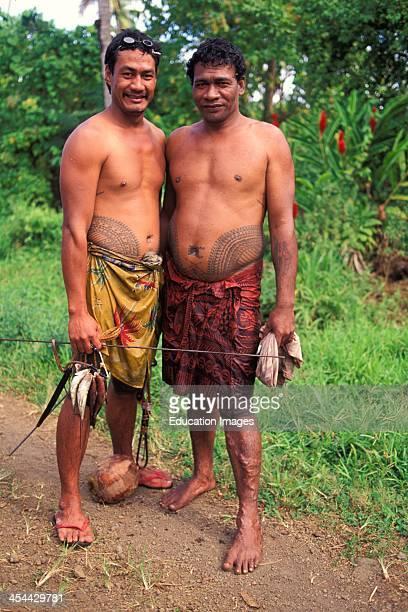 Western Samoa Island Of Upolu Southern CoaSt Vavau Two Spear fishermen With Tattoos
