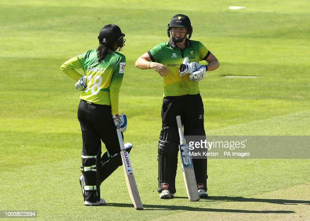 Western Storm Captain Heather Knight speaks with Smriti Mandhana during the Kia Super League match at The Cooper Associates County Ground Taunton