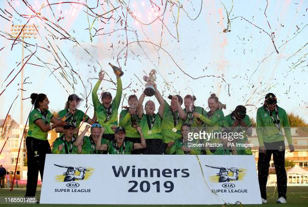 Western Storm' Heather Knight celebrates with the trophy with teammates after winning during Kia Super League final at the 1st Central County Ground...