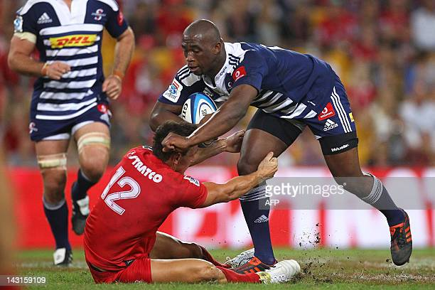 Western Stormers player Siya Kolisi is tackled by Queensland Reds player Mike Harris during the Super 15 rugby match at the Suncorp Stadium in...