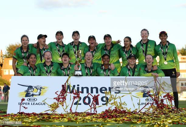 Western Storm's Heather Knight celebrates with the trophy with teammates after winning during Kia Super League final at the 1st Central County Ground...