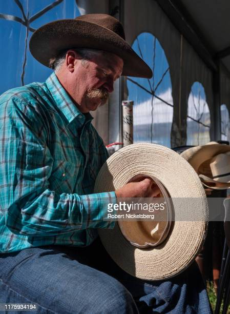 Western style hat maker Brook Biddle sews in a hat brim for a customer in Carbondale, Colorado on September 12, 2019. Biddle is the owner of Powder...