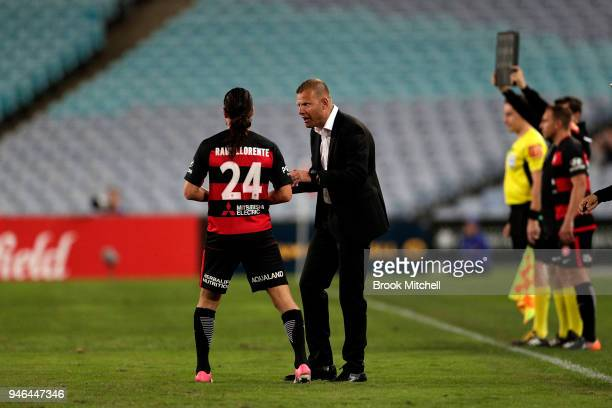 Western Sydney Wanderers coach Josep Gombau speaks with Raul Llorente of the Western Sydney Wanderers during the round 27 ALeague match between the...