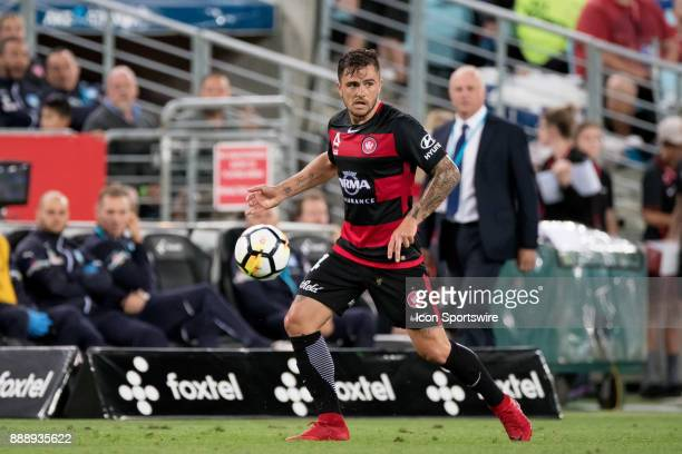 Western Sydney Wanderers defender Josh Risdon takes the ball downfield at the Hyundai ALeague match between Western Sydney Wanderers and Sydney FC on...