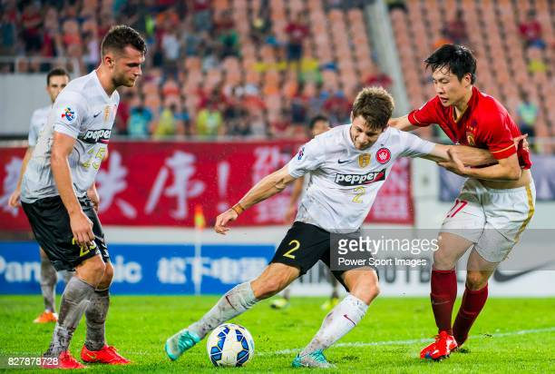 Western Sydney Wanderers defender Shannon Cole fights for the ball with Guangzhou Evergrande midfielder Zheng Long during the AFC Champions League...