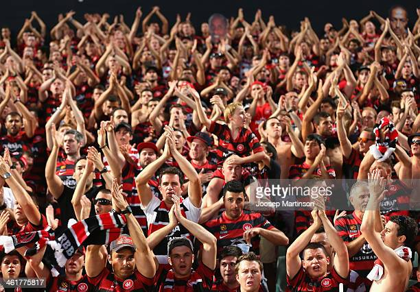 Western Sydney Wanderers fans cheer during the round 14 ALeague match between the Western Sydney Wanderers and Sydney FC at Parramatta Stadium on...
