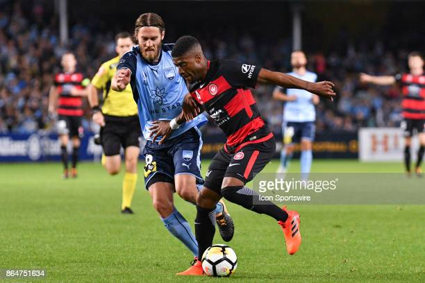 Western Sydney Wanderers midfielder Roly Bonevacia and Sydney FC midfielder Joshua Brillante fight for the ball at the Hyundai ALeague match between...