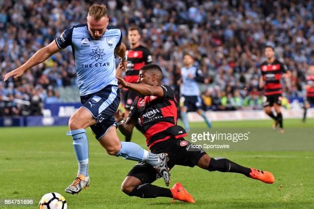 Western Sydney Wanderers midfielder Roly Bonevacia gives Sydney FC defender Jordy Buijs a push at the Hyundai ALeague match between Sydney FC and...
