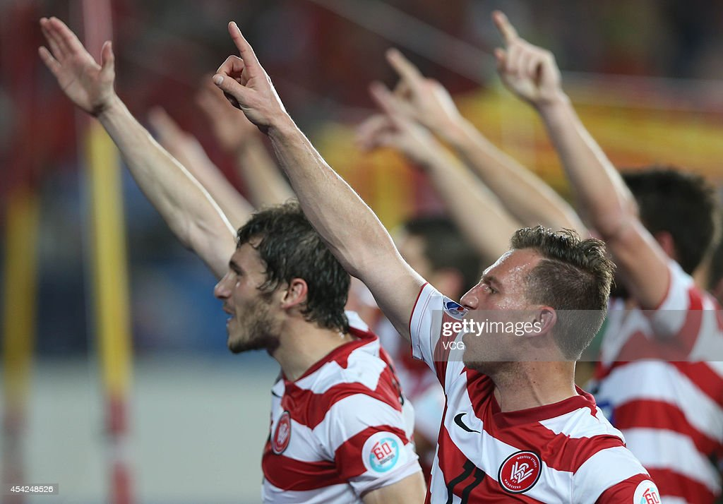 Western Sydney Wanderers players celebrate after the Asian Champions League quarter-final match between Guangzhou Evergrande and Western Sydney Wanderers at Tianhe Sports Center on August 27, 2014 in Guangzhou, China.