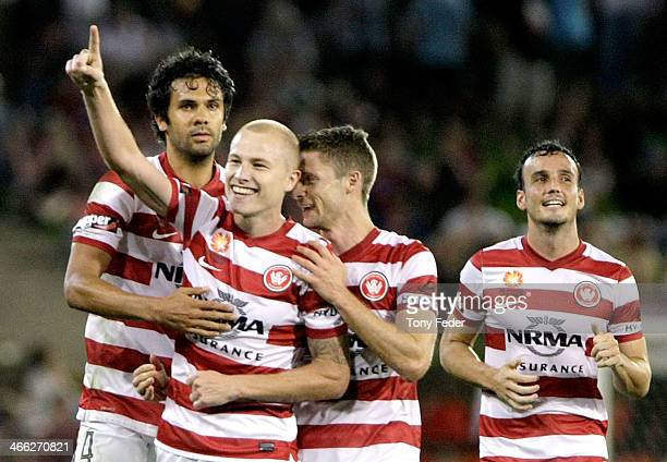 Western Sydney Wanderers team mates celebrate a goal during the round 17 ALeague match between Newcastle Jets and the Western Sydney Wanderers at...