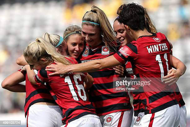 Western Sydney Wanderers team mates celebrate a goal during the round seven A-League match between the Western Sydney Wanderers and Canberra United...