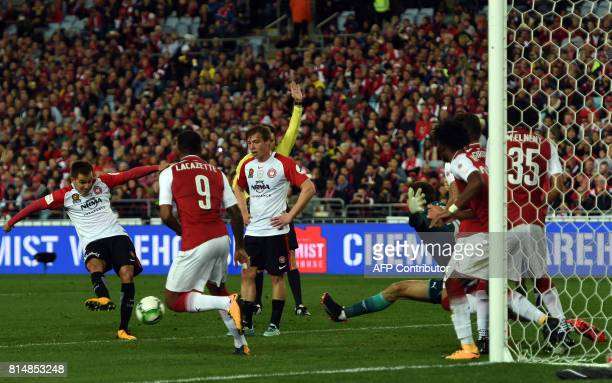 Western Sydney's players Steven Lustica kicks the ball in Arsenal's goal poat for a successful goal during a friendly game in Sydney on July 15 2017...