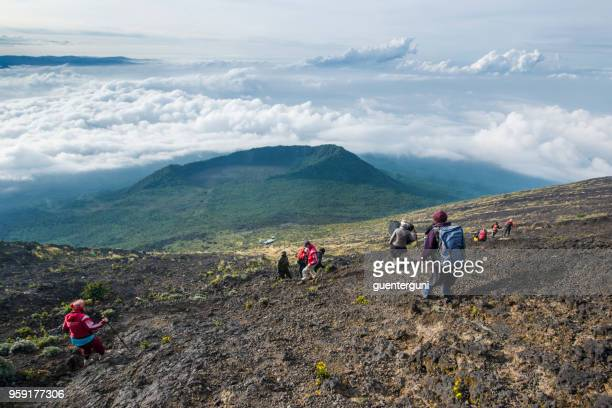 western tourist descending from nyiragongo volcano, congo - virunga national park stock pictures, royalty-free photos & images