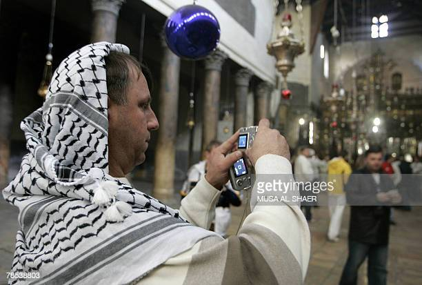 A western tourist wearing a Kefiyeh takes photographs at the Church of the Nativity traditionally believed to be the birthplace of Jesus Christ in...