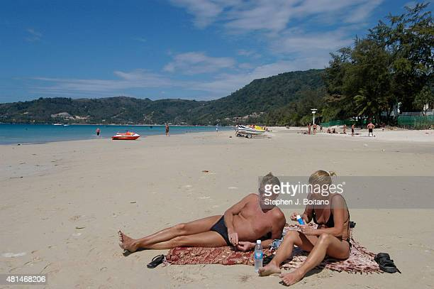 Western tourists sit on the deserted Patong beach in Phuket Thailand after the Dec 26 2004 Tsunami