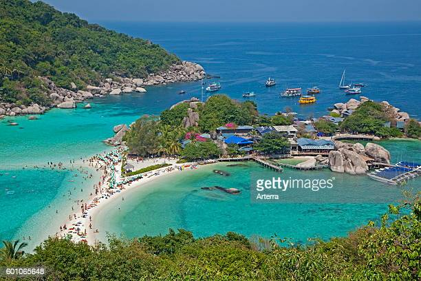 Western tourists sunbathing on beach of Ko Nang Yuan / Nangyuan small island famous for its diving spots and great snorkelling near Ko Tao along the...