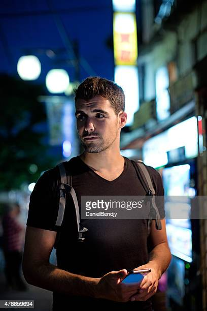 Western Traveler in Tokyo At Night