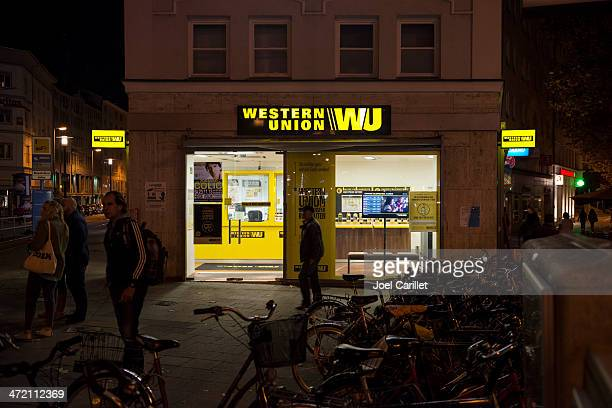 western union office in germany - money transfer stock pictures, royalty-free photos & images