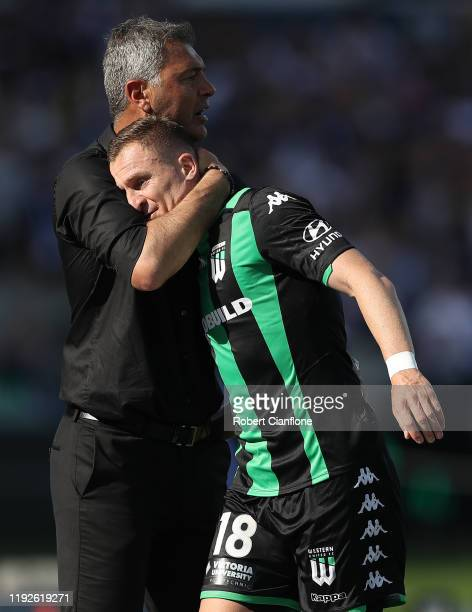 Western United coach Mark Rudan hugs Besart Berisha of Western United after he was substituted during the round nine ALeague match between Western...
