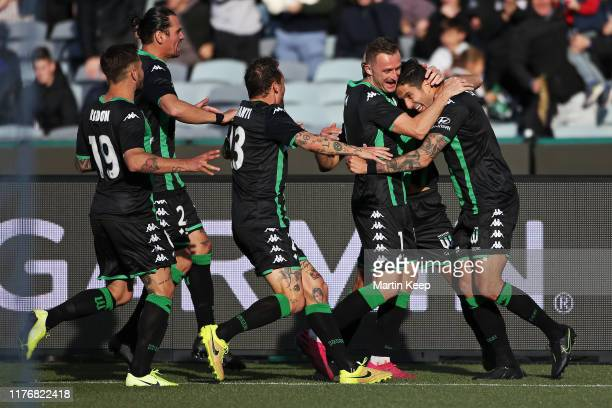 Western United players celebrate a goal during the round two ALeague match between Western United and Perth Glory at GMHBA Stadium on October 19 2019...