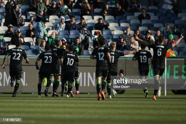 Western United players celebrate after Panagiotis Kone of Western United scores during the round two ALeague match between Western United and Perth...