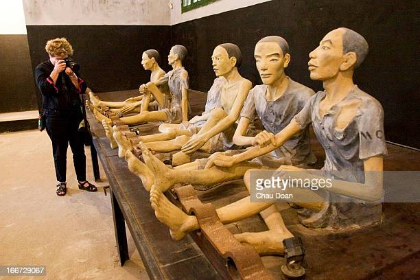 Western visitor takes picture of statue built as prisoners in Hoa Lo museum The museum known widely by the nickname 'Hanoi Hilton' given to it by the...