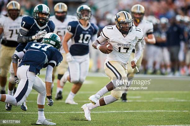 Westfield quarterback Rehman Johnson breaks through the defense in second quarter action against South County at South County Secondary School on...