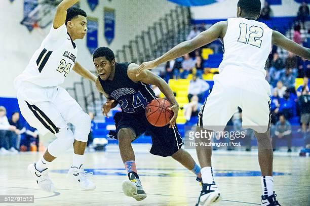 Battlefield's Jarrett Glover splits the Westfield defense during second quarter action in the Virginia 6A Northern Regional boy's basketball final on...
