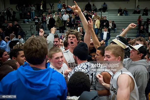 Westfield's Zach Sheahan celebrates with the rest of his team and fans after defeating Herndon 6654 in the Virginia Conference 5 Basketball...