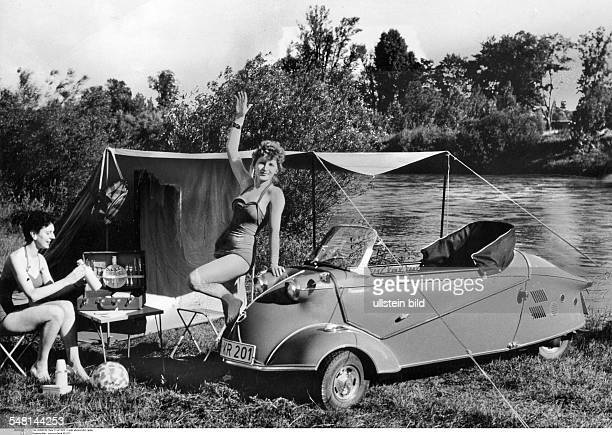 WestGermany Bavaria Two young women camping at a lake In the front is a bubblecar Messerschmitt Roadster KR 201 July 1959 Also available in color...