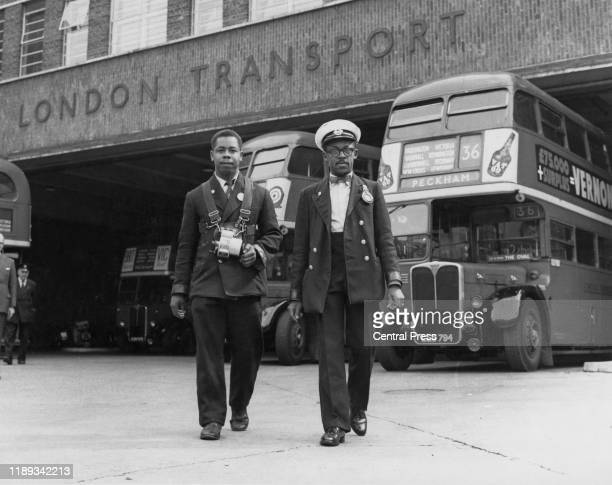 West-Indian London Transport bus driver and his conductor at Peckham Bus Garage, south London, September 1958. The driver's PSV licence badge is...