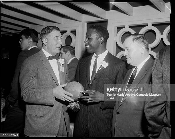 Westinghouse High School football coach Pete Dimperio and Milwaukee Braves baseball player Hank Aaron holding football at Pittsburgh Dapper Dan...