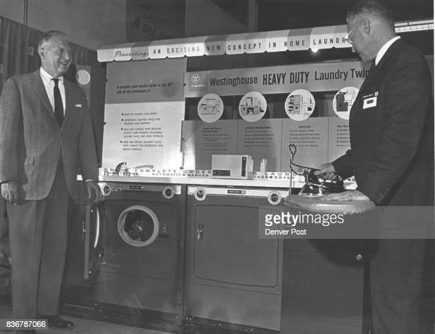 Westinghouse Previews 1964 Appliances C W Krieder left vice president and treasurer of the McCollumLaw Corp watches W S Law president and general...