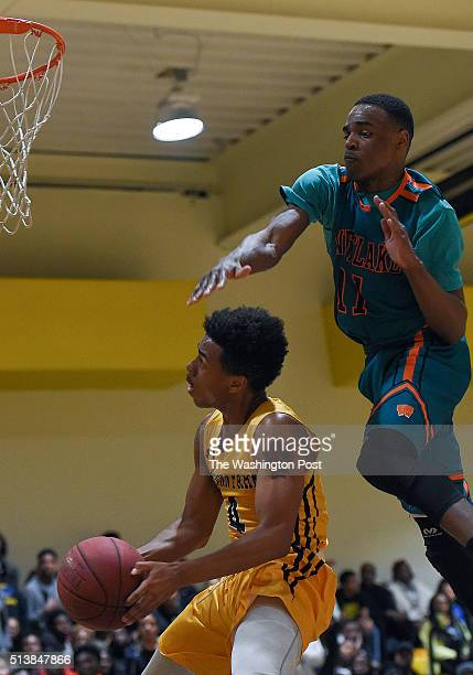 Westlake's Everett Mouton fouls Gwynn Park's Marlon White from behind as he goes sup for two during the Maryland 2A South Region boys' basketball...