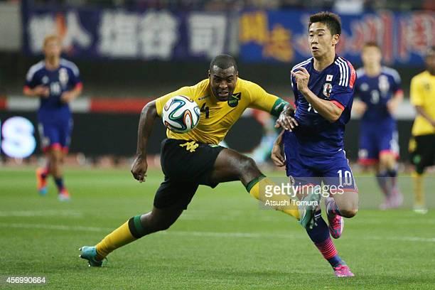 Westley Morgan of Jamaica and Shinji Kagawa of Japan competes for the ball during the international friendly match between Japan and Jamaica at Denka...