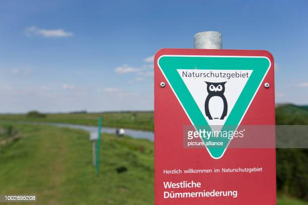 'Westliche Duemmeniederung' and 'Naturschutzgebiet' is written on a sign at the Hunte an inflow of the Duemmer lake near Lemfoerde Germany 22 May...