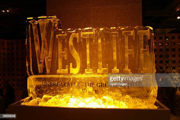 """Westlife display at the """"Unbreakable"""" album launch at the Zuma Restaurant on November 11, 2002 in London."""