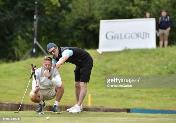 Westlife music artist Nicky Byrne is given instructions by his caddie during the Pro Am event at The ISPS HANDA World Invitational at on July 28,...