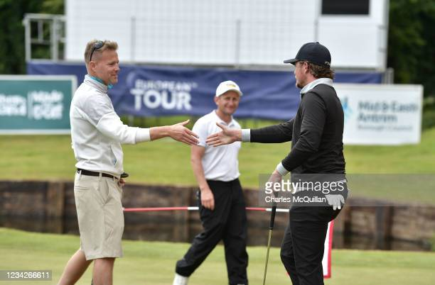 Westlife music artist Nicky Byrne shakes hands with Eddie Pepperell during the Pro Am event at The ISPS HANDA World Invitational at on July 28, 2021...