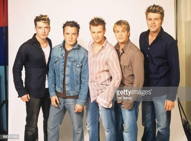 Westlife , pop group, 2002.