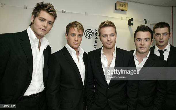 Westlife pose at the launch of the all new Top Of The Pops at BBC Television Centre on November 28 2003 in London