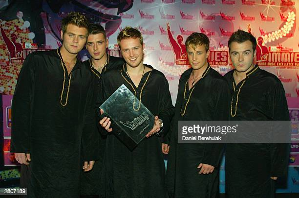 Westlife pose for a photograph during the Inaugural MTV IMMIES at the Goregaon Sports Club December 12 2003 in Mumbai India