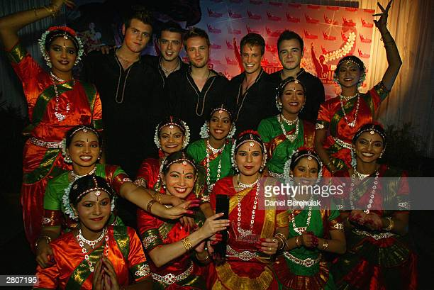 Westlife pose for photographs during the Inaugural MTV IMMIES at the Goregaon Sports Club December 12 2003 in Mumbai India