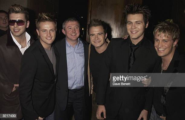 Westlife with their manager Louis Walsh during the party that boyband 'Westlife' threw to celebrate reaching number one in the charts and hail the...