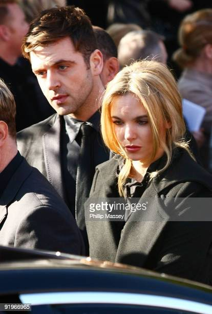 Westlife's Mark Feehily and Jodi Albert attend the funeral of Boyzone member Stephen Gately on October 17 2009 in Dublin Ireland
